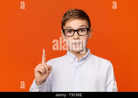 Smart teen boy in glasses having idea - Stock Photo