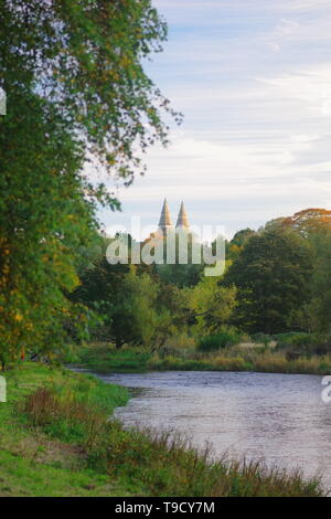St Machars Cathedral beyond he River Don on a Calm Autumn Evening. Seaton Park, Old Aberdeen, Scotland, UK. - Stock Photo