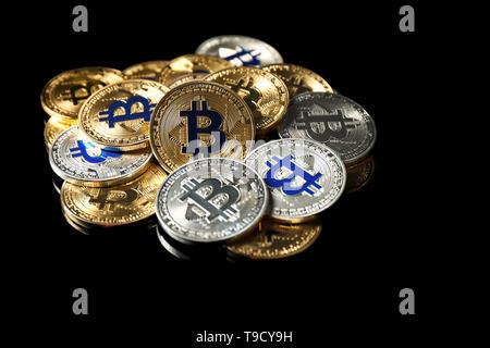 Bitcoins on black background - Stock Photo