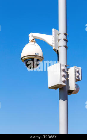 Samara, Russia - May 10, 2019: Surveillance CCTV cameras mounted on post against the blue sky - Stock Photo