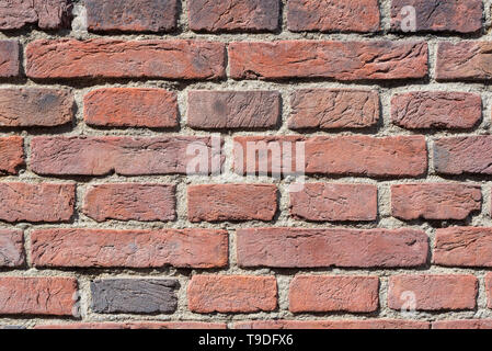 old red brick wall texture close-up background in sunlight - Stock Photo