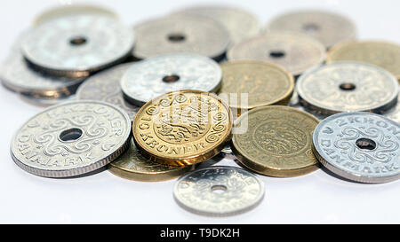 Pile of mixed Danish coins with selective focus. The krone is the official currency of Denmark, Greenland and the Faroe Islands. - Stock Photo
