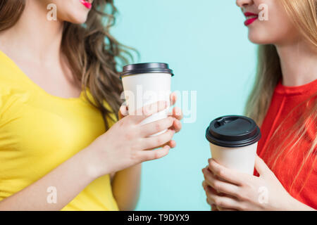 Two smiling students having a cup of coffee, close up - Stock Photo