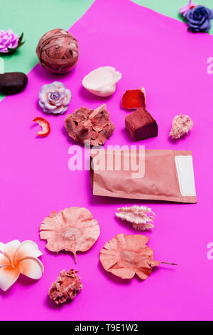 Abstract Spa items on pink background. Beauty care concept - Stock Photo