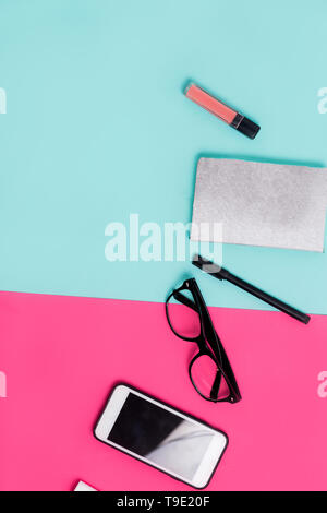 Womens office materials on pink and blue background. Flat lay, Top view. Minimalism - Stock Photo