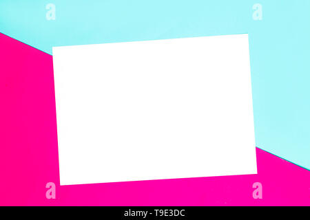 Colorful of soft blue and pink paper background with white paper frame for text - Stock Photo
