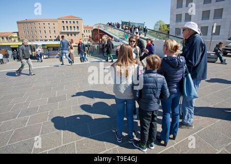 Tour group Constitution Bridge, Ponte della Costituzione Venice - Stock Photo