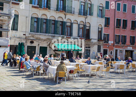People at an outdoor restaurant - Stock Photo