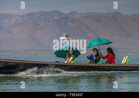 Tourist boat on the Inle lake - Stock Photo