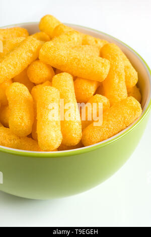Cheese flavored puffed corn snacks in a bowl - Stock Photo