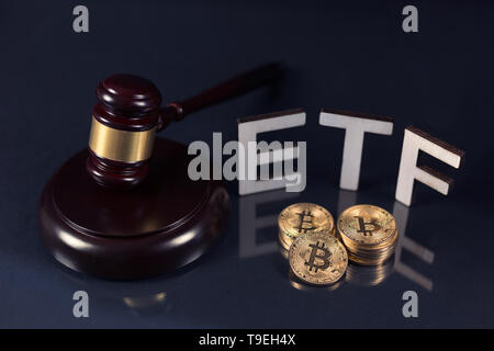 Bitcoin coins with ETF text and gavel put on dark background, Concept of the approval of Exchange Traded Fund. - Stock Photo