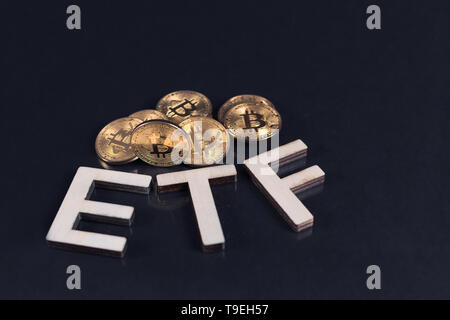 Bitcoin coins with ETF text put on dark background, Concept of the approval of Exchange Traded Fund. - Stock Photo