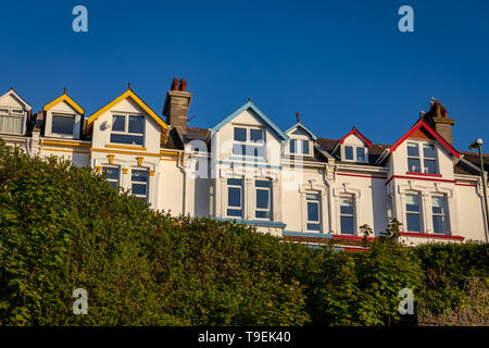 Bright Colourful Houses Overlooking Brixham Harbour and Marina,Torbay,Devon.England - Stock Photo