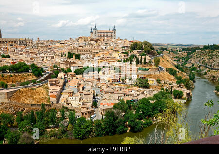 overview, old walled city; medieval; Tagus River, buildings, UNESCO site; Europe; Toledo; Spain; spring; horizontal - Stock Photo
