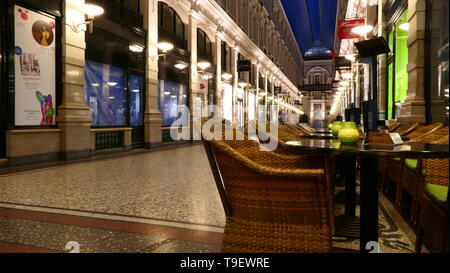 THE HAGUE, THE NETHERLANDS - APRIL 21, 2019: The shopping Passage within the city centre by night - Stock Photo
