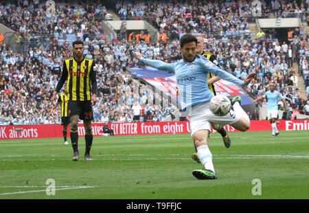 London, UK. 18th May, 2019. David Silva (MC) scores the first Man City goal (1-0) at The Emirates FA Cup Final, Manchester City v Watford, at Wembley Stadium, London, UK on May 18, 2019. **Editorial use only, license required for commercial use. No use in betting, games or a single club/league/player publications** Credit: Paul Marriott/Alamy Live News - Stock Photo
