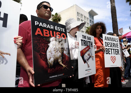 Los Angeles, CA, USA. 27th Feb, 2019. Animal rights activists seen holding placards during a protest of what they called, animal cruelty in the chicken supply chain of McDonald's. The protest took place in front of a McDonald's fast food restaurant on the Hollywood Walk of Fame in Los Angeles. Credit: Ronen Tivony/SOPA Images/ZUMA Wire/Alamy Live News - Stock Photo