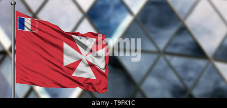 Wallis And Futuna flag waving in the wind against blurred modern building. Business concept. National cooperation theme. - Stock Photo