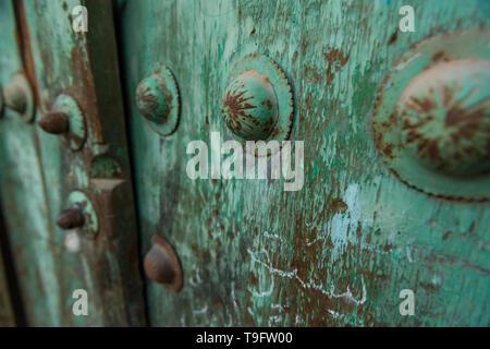 Weathered entrance door in Iran. - Stock Photo