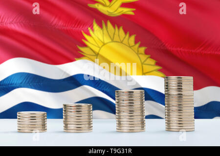 Kiribati flag waving in the background with rows of coins for finance and business concept. Saving money. - Stock Photo
