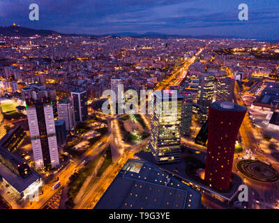 Panoramic view from drone of night Barcelona. Plaza de Europa with Fira Barcelona Gran Via conference center - Stock Photo