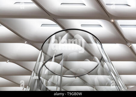 Interior detail showing glass elevator and gallery ceiling at The Broad Art Museum in Los Angeles, California. - Stock Photo