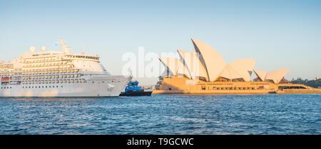 SYDNEY, AUSTRALIA - FEBRUARY 11, 2019: The Seven Seas Navigator cruise liner passing Sydney Opera House  prior to docking in Sydney Harbour. - Stock Photo