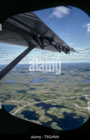 Aerial view of James Bay region from a Twin Otter window. Quebec, Canada. - Stock Photo
