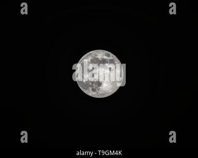 Full moon on the dark night sky - Stock Photo