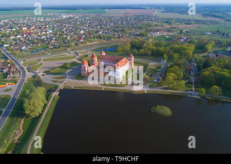Mir Castle in the cityscape on april morning (aerial photography). Belorussia - Stock Photo