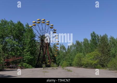 The ferris wheel in the abandoned Pripyat amusement park, Chernobyl exclusion zone, Ukraine - Stock Photo
