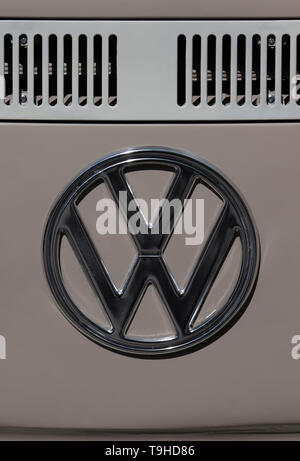 VW logo on an old VW bus in Germany - Stock Photo