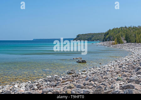 Remote Gravel Beach in the Great Lakes on Lake Huron in Bruce Peninsula National Park in Ontario - Stock Photo
