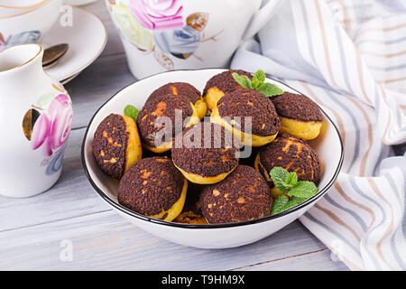 Shu Cake. Tasty profiterole with cream on the plate. Copy space - Stock Photo