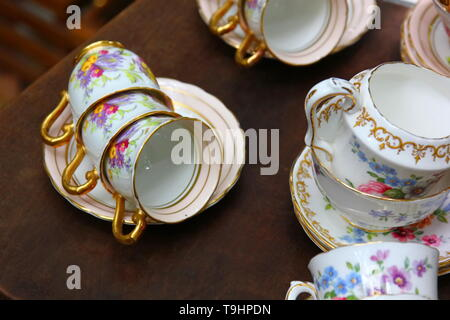 ceramic tea cup set on bronw wood floor - Stock Photo