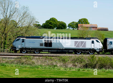A Chiltern Railways Class 68 diesel locomotive pulling a Mainline service train, Warwickshire, UK - Stock Photo