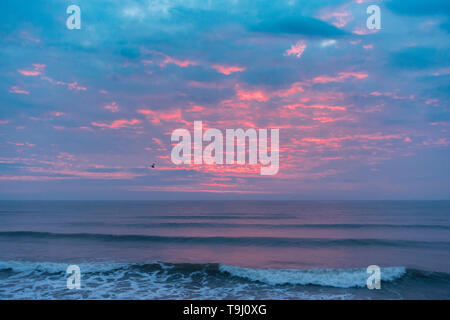 Seaton Carew, County Durham, UK. 19th May 2019. UK weather: crepuscular rays at sunrise as the sun illuminates a thin layer of cloud on a glorious Sunday morning at Seaton Carew on the north east coast of England. Credit: Alan Dawson/Alamy Live News - Stock Photo