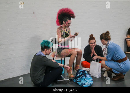 London, UK. 19th May 2019.  Battle of the Brushes at IMATs 2019 chilling after the competition Credit: Paul Quezada-Neiman/Alamy Live News - Stock Photo