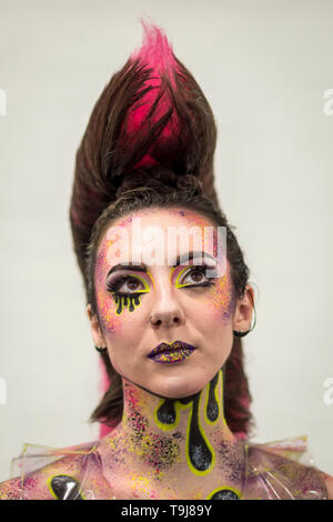 London, UK. 19th May, 2019. A model wears a completed make-up artist's design at the International Make-Up Artists Trade Show (IMATS) taking place at Kensington Olympia 17 to 19 May 2019. The show brings together make-up artists from around the world, including those with Hollywood movie backgrounds, providing classes in theatre, film, TV, fashion and editorial make-up to professionals and enthusiasts. Credit: Stephen Chung/Alamy Live News - Stock Photo