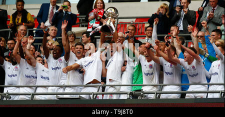 London, UK. 19th May, 2019.  AFC Fylde players with Trophy during Bulidbase FA Trophy Final match between AFC Fylde and Leyton Orient at Wembley stadium, London on 19 May 2019 Credit: Action Foto Sport/Alamy Live News - Stock Photo