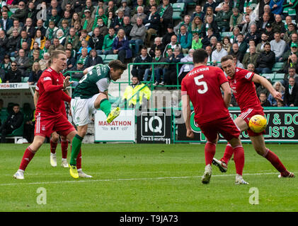 Edinburgh, Scotland, UK. 19th May, 2019.  Pic shows: Hibs' midfielder, Lewis Stevenson, shoots for goal during the second half as Hibs play host to Aberdeen at Easter Road Stadium, Edinburgh Credit: Ian Jacobs/Alamy Live News - Stock Photo