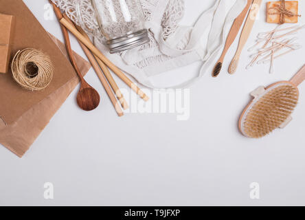Zero waste concept. Reusable and natural material items for bathroom, kitchen and hygiene on the white background, top view - Stock Photo