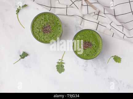 Green smoothie with spinach, kale and apple in glasses top view. Healthy nutrition - Stock Photo
