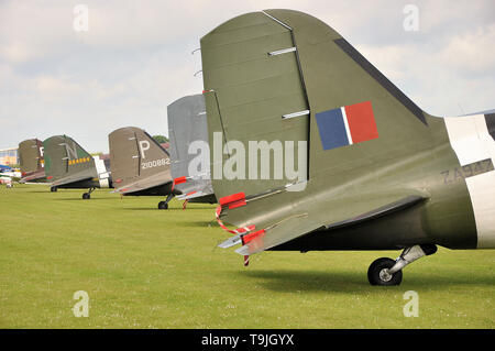 Douglas C-47 Skytrain planes in period camouflage markings - including D Day 'invasion stripes' - together in Europe for the first time in many years - Stock Photo
