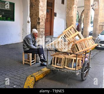 March 10, 2019, Casablanca, Morocco: Craftsman, carpenter, manufacturing chairs and selling their goods on the streets of Casablanca in Morocco - Stock Photo