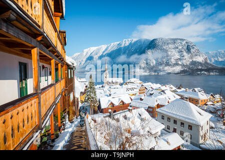 Panoramic view of the historic village of Hallstatt on a beautiful cold sunny day with blue sky and clouds in winter, Austria - Stock Photo