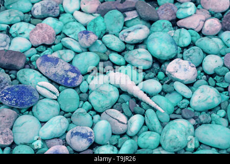Pebble Stones Path with Tiny Seashells on the Beach in Pastel Blue Tone - Stock Photo