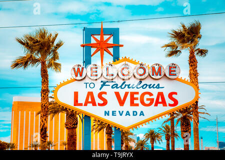 Classic view of Welcome to Fabulous Las Vegas sign at the south end of world famous Las Vegas strip on a beautiful sunny day with blue sky and clouds - Stock Photo