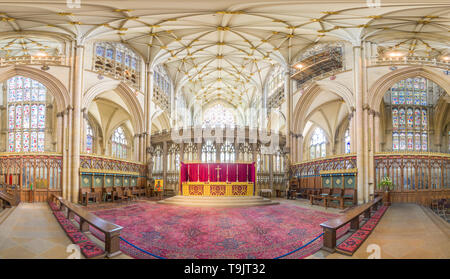 High altar and quire (choir) surrounded by stained glass windows in the medieval christian minster (cathedral) at York, England. - Stock Photo
