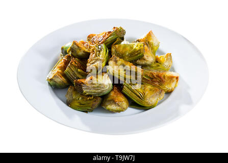 Appetizing artichokes fried in oil. Isolated over white background - Stock Photo